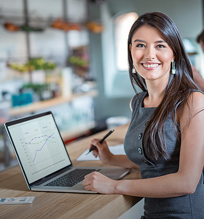 Female professional with analytics displayed on computer