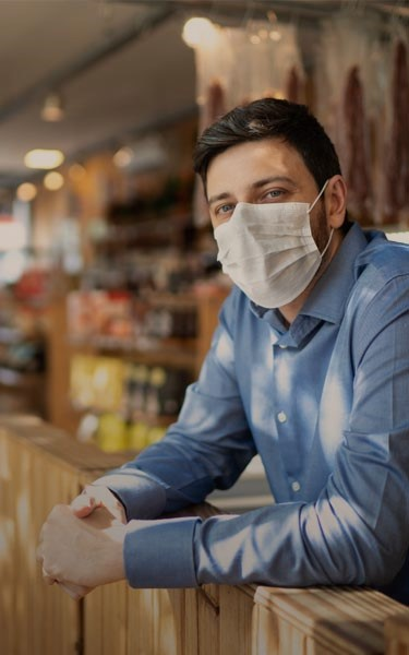 man in restaurant with mask