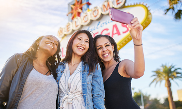 girls smiling and taking selfie