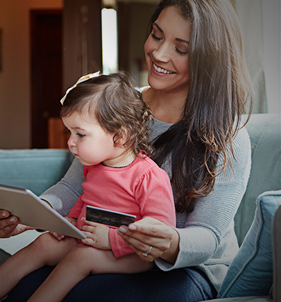 Woman using tablet with child on lap