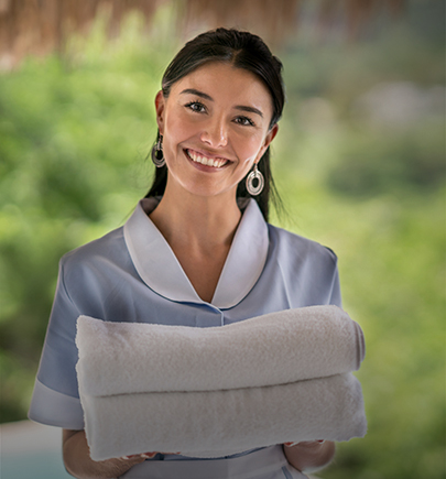 Hotel staff handing towels to guest