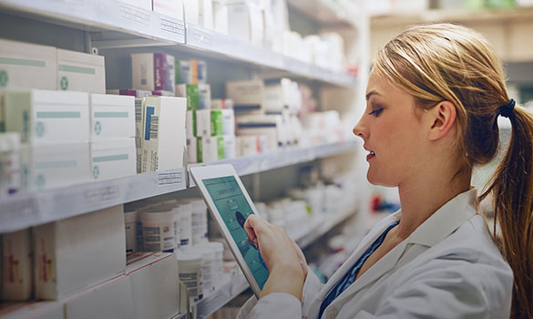 Mckesson Pharmacy Systems doctor working on tab