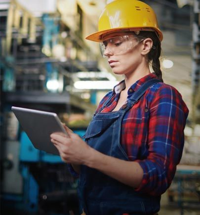 Female factory worker looking at tablet